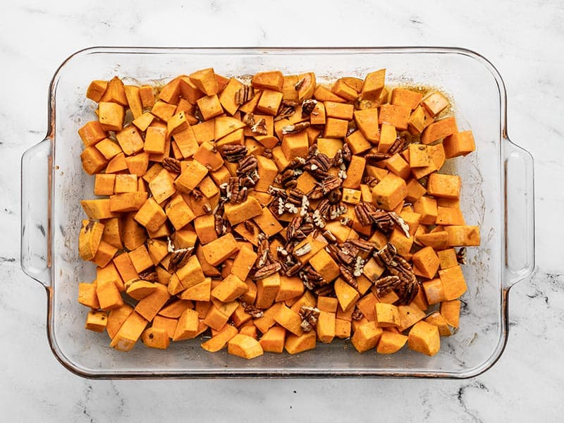 Pecans added to half roasted sweet potatoes