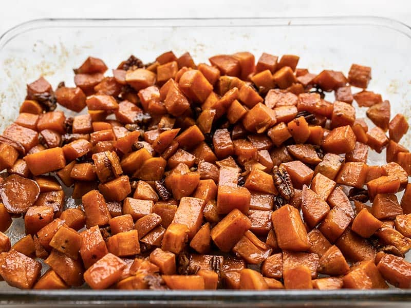 front view of roasted sweet potatoes in the casserole dish