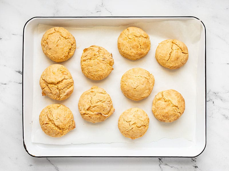 Baked sweet potato biscuits on a baking sheet