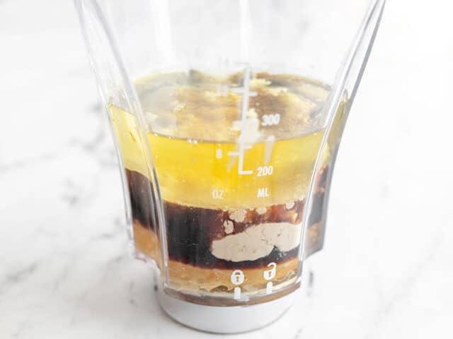 Sesame ginger dressing ingredients in a blender