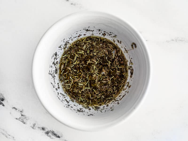 Garlic Herb Oil mixture in a small bowl