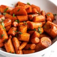 close up side view of a bowl of honey balsamic glazed carrots