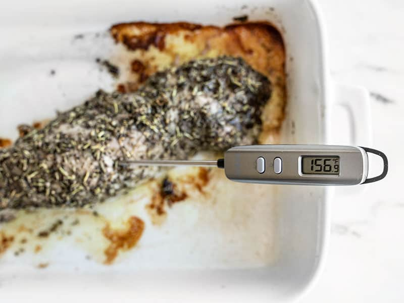 Meat thermometer in the roasted pork tenderloin