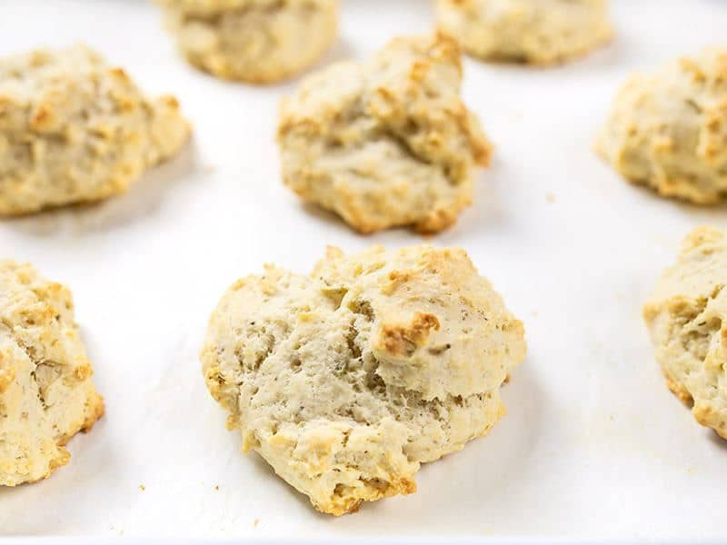 Front view of baked Rosemary Pepper Drop Biscuits on the baking sheet.