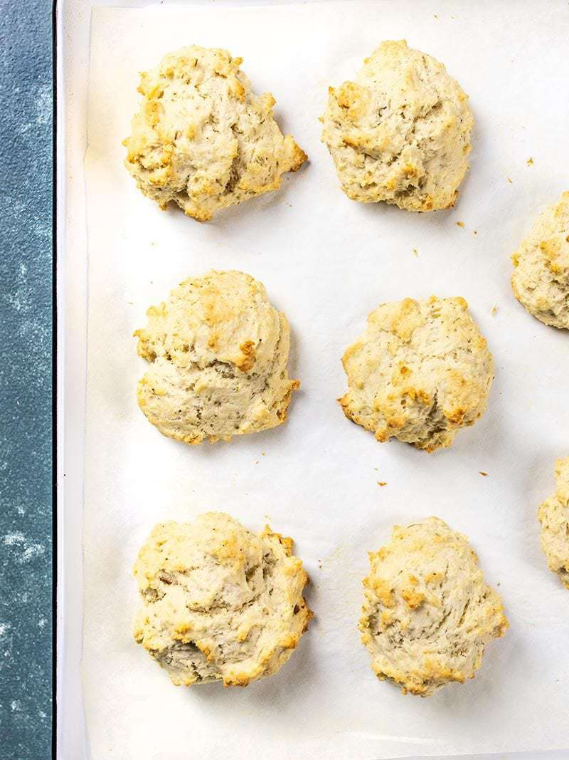 Baking sheet with baked Rosemary Pepper Drop Biscuits.