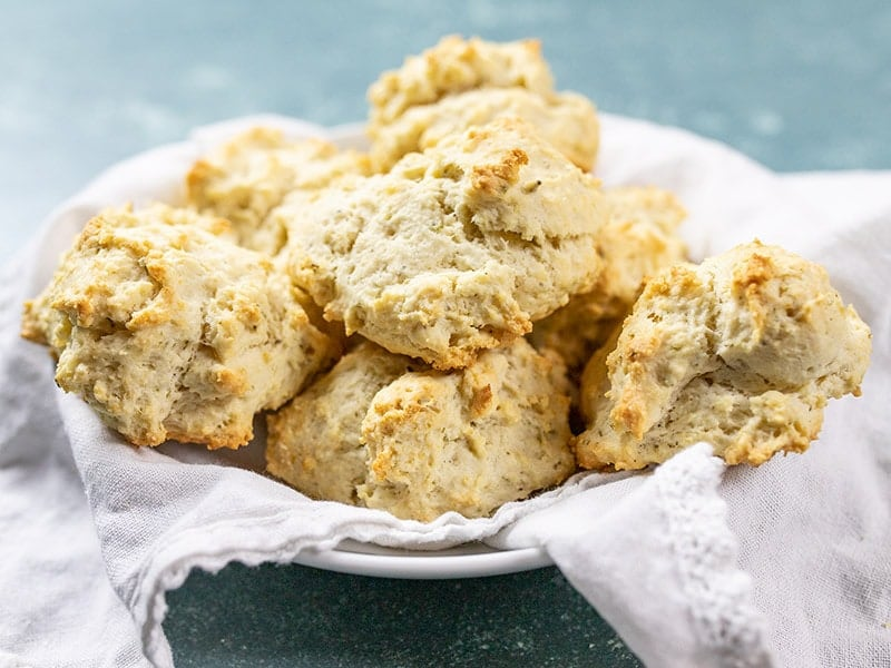 A basket full of freshly baked Rosemary Pepper Drop Biscuits