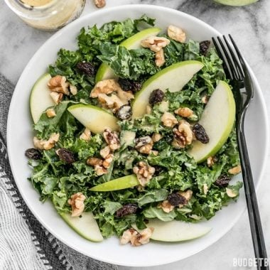 This Apple Dijon Kale Salad is tangy, sweet, and crunchy with Granny Smith apples, walnuts, raisins, and a homemade Dijon vinaigrette. BudgetBytes.com