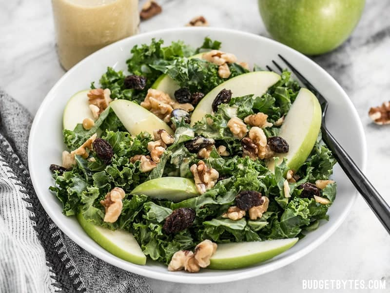 A bowl of Apple Dijon Kale Salad from the front