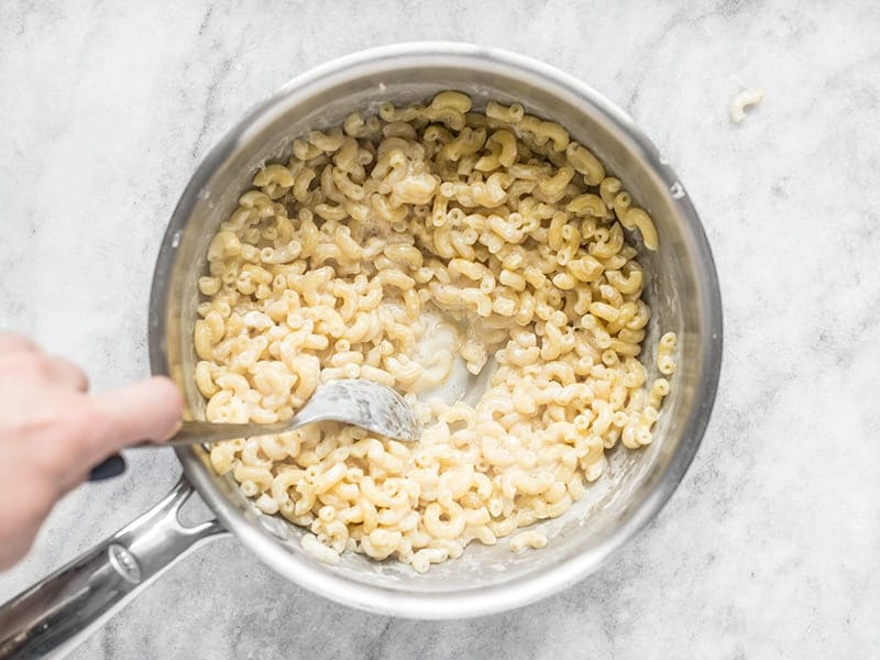 Macaroni simmered in milk in the sauce pot until tender