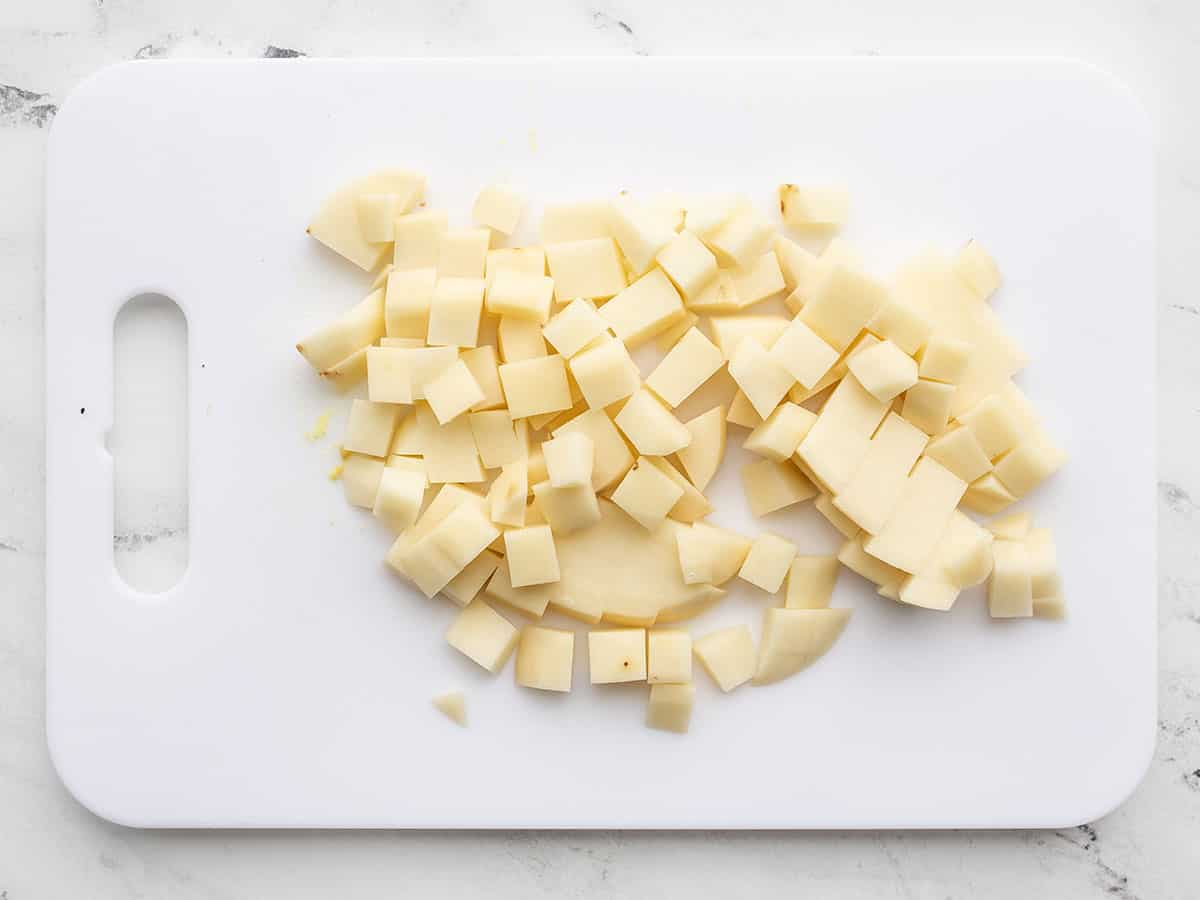 Cubed potato on a cutting board