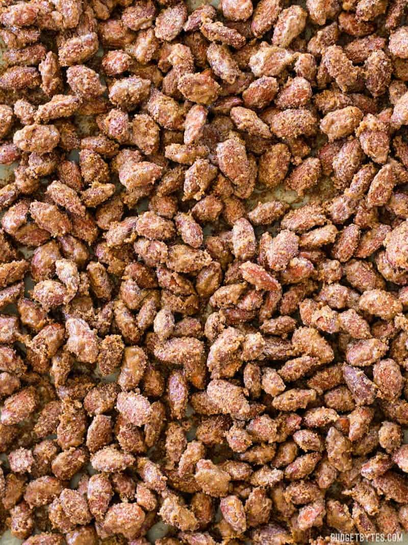 Close up of homemade candied almonds on a baking sheet
