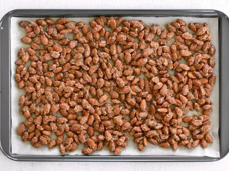 Candied Almonds spread on parchment lined baking sheet