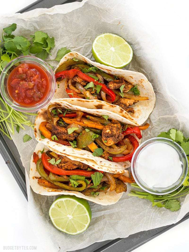 Prepared Easy Oven Fajitas ready for serving with salsa and sour cream