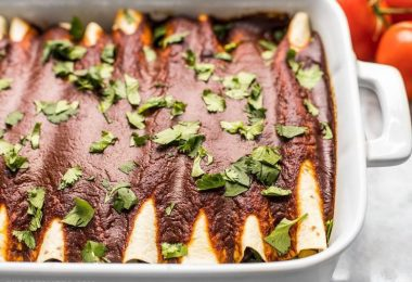 These hearty vegan Black Bean and Avocado Enchiladas are stuffed with fresh ingredients and drenched in a homemade sauce for big flavor in every bite. BudgetBytes.com