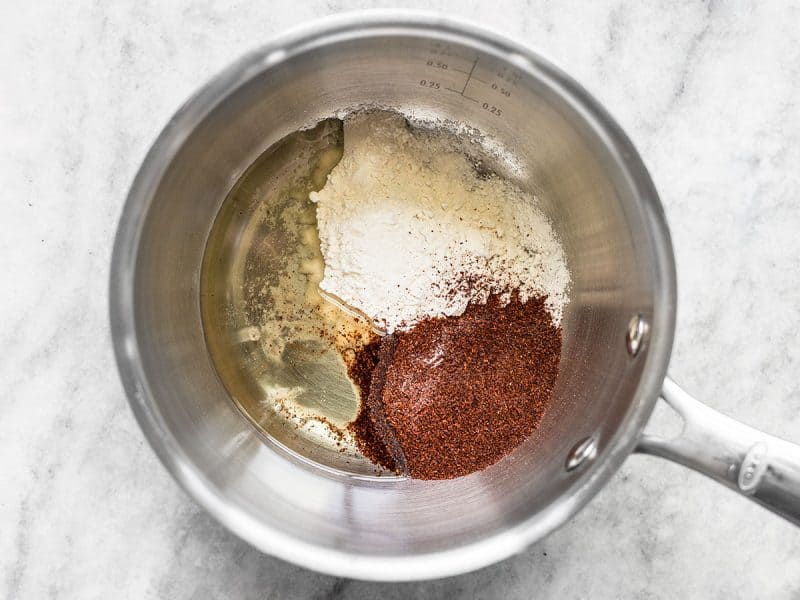 Flour, oil, and chili powder in sauce pot