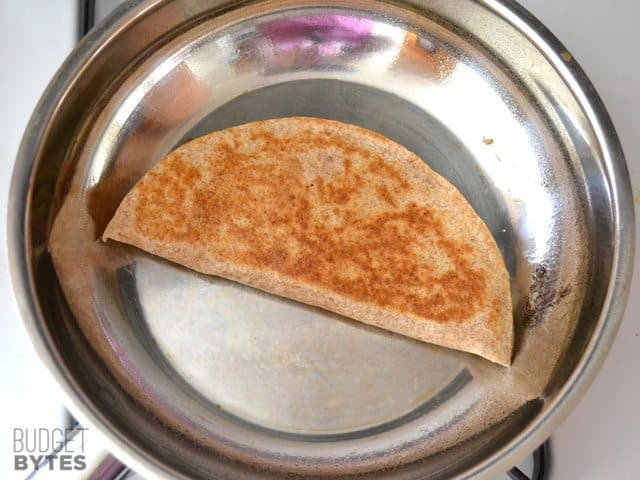 cooking quesadilla in skillet