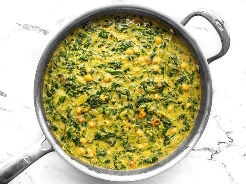 finished chana saag in the skillet