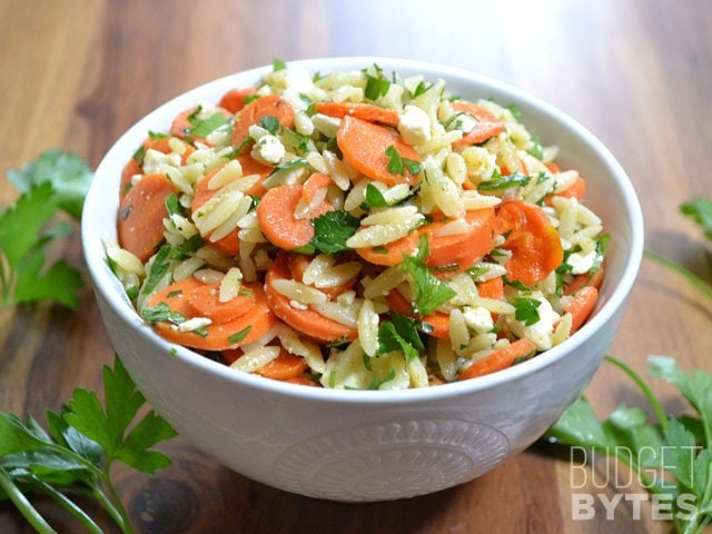 Sideview of a bowl of Carrot & Orzo Salad