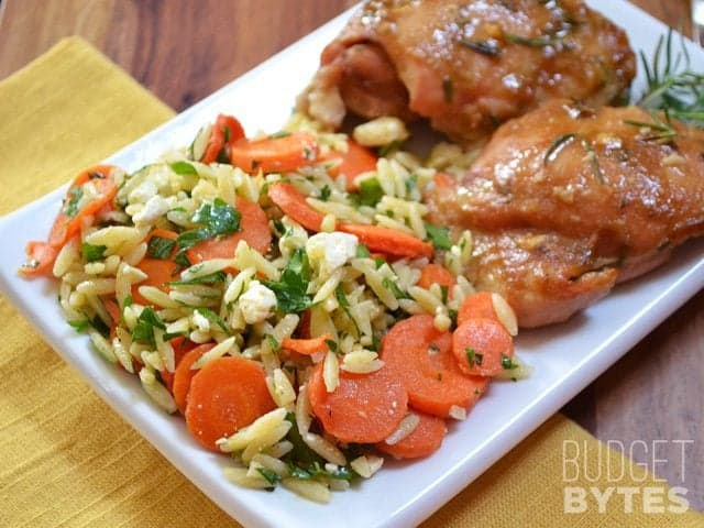 Carrot & Orzo Salad, paired with chicken, on plate