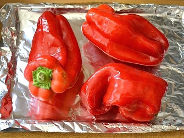 peppers coated in oil and placed on baking sheet lined with tin foil