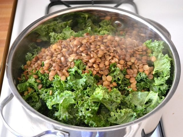 kale and lentils added to pot