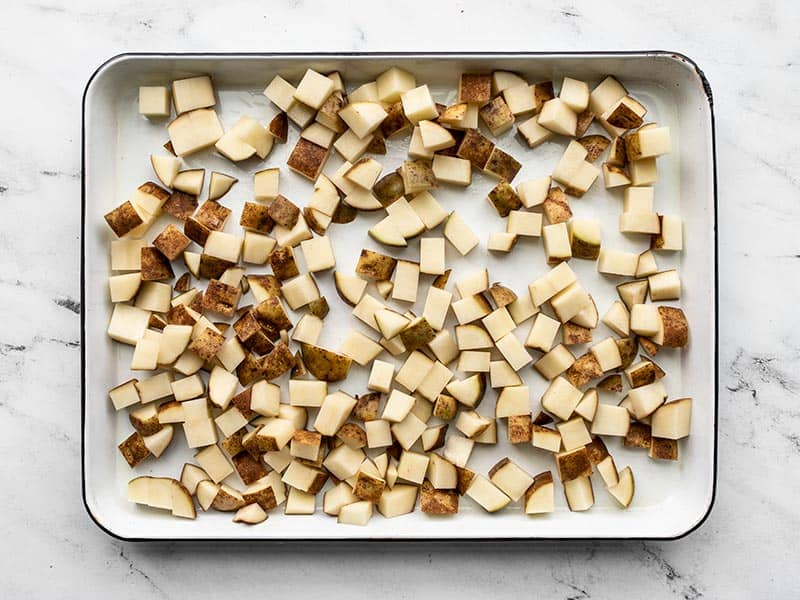 Diced potatoes on a baking sheet