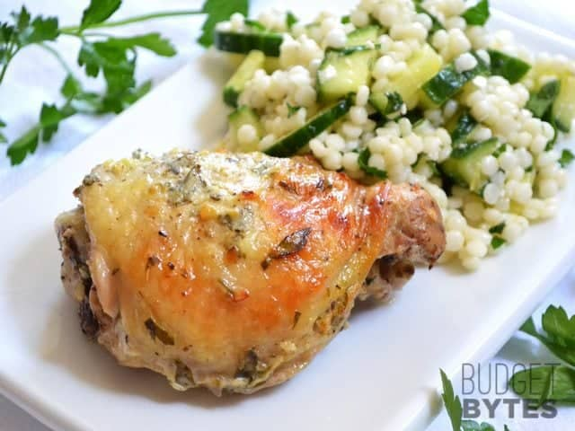 Greek Marinated Chicken is flavored with a garlicky lemon and yogurt marinade and baked (or grilled) till tender. BudgetBytes.com BudgetBytes.com