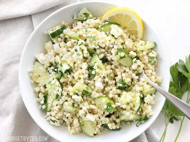 Close overhead view of Lemony Cucumber Couscous Salad with a fork stuck in the side.
