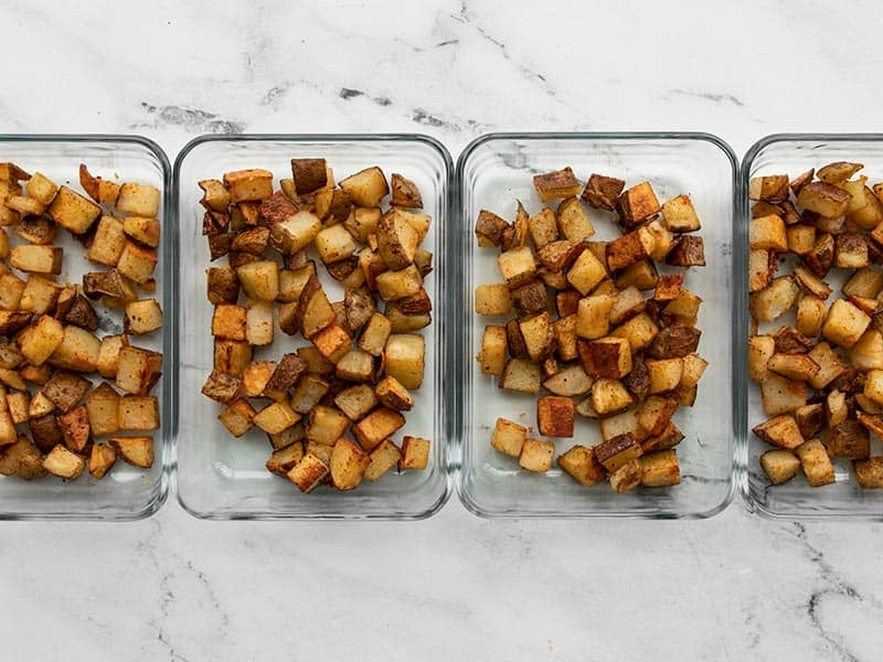 Roasted potatoes in rectangular glass meal prep containers