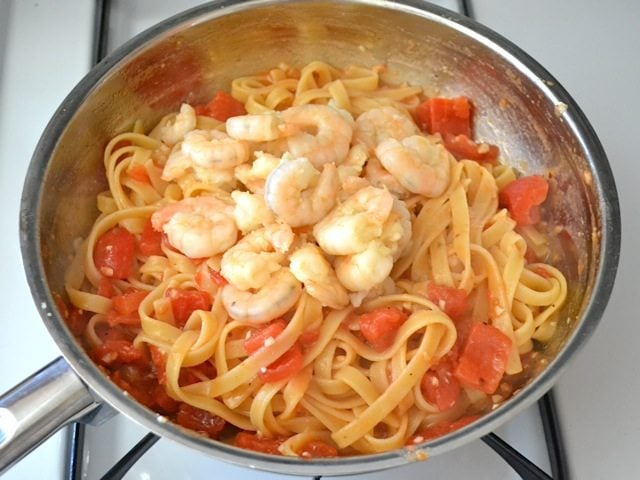 Shrimp added to skillet with pasta and sauce