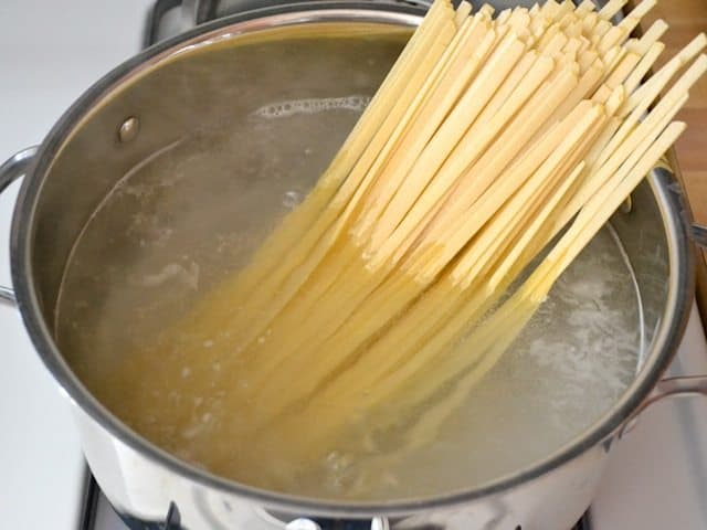 Pasta added to pot of boiling water
