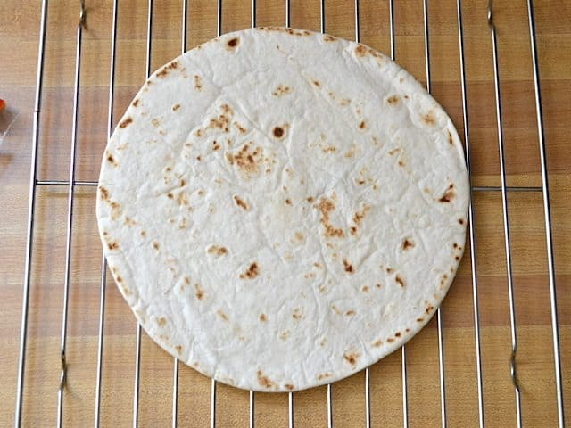 baked tortilla on wire cooling rack