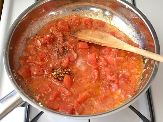 Tomatos and Pepper in skillet to make sauce