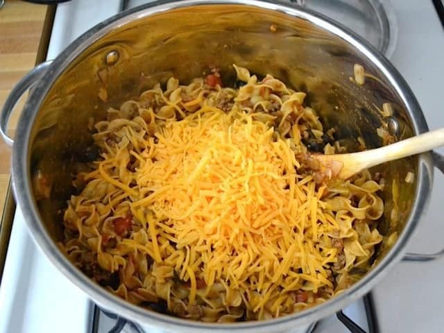 Shredded cheese added to pot