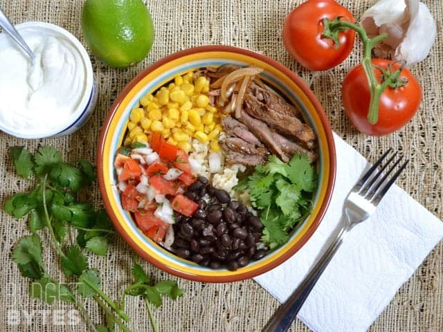 Top view of a Southwest Steak Bowl with staged ingredients on side