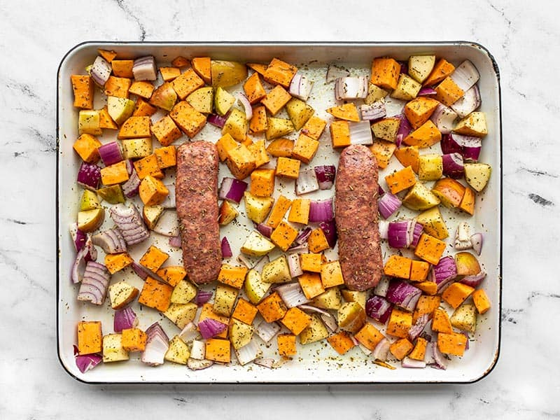 autumn medley ready to roast on the sheet pan