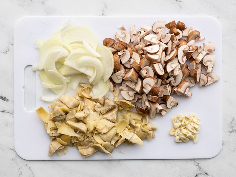 Sliced onion mushrooms garlic and artichoke hearts