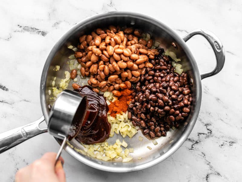 Add Beans BBQ Sauce and Smoked Paprika to the skillet