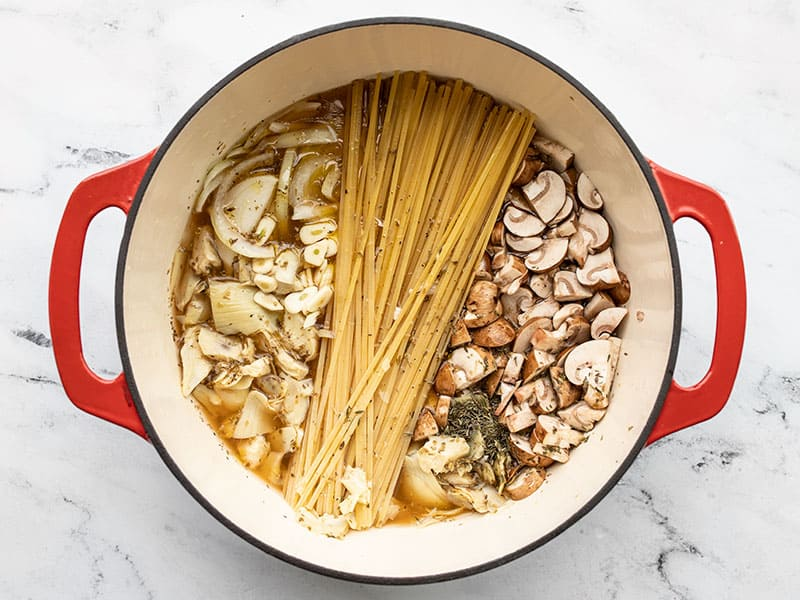 Ingredients pushed down in the pot below the broth