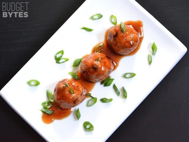 Three Turkey Sriracha Meatballs on a white plate