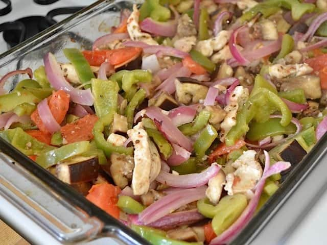 stirred and cooked veggies and chicken in baking dish