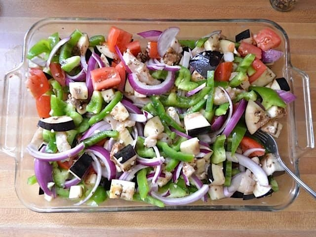 Marinade poured over top veggies in baking dish