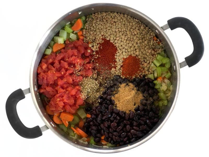 Add Beans Lentils Tomatoes and Spices