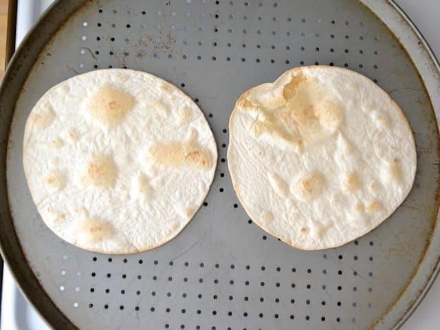 Golden brown Baked Tortillas on pizza pan