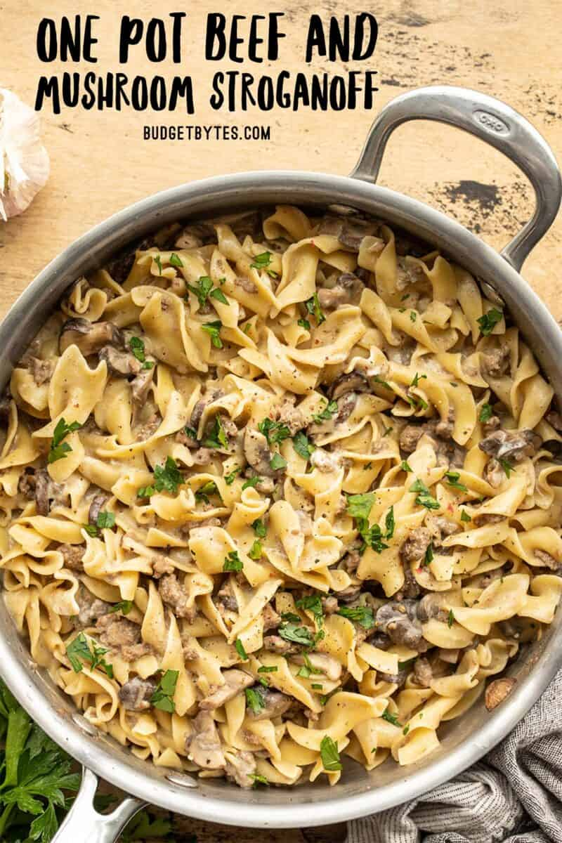 overhead view of one pot beef and mushroom stroganoff in the skillet with title text at the top