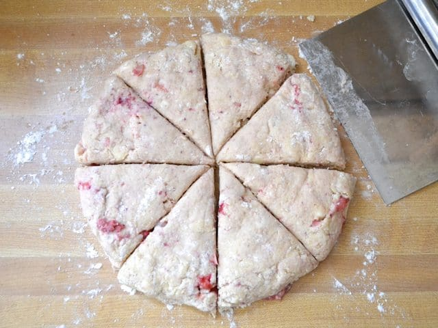 dough formed into circle and cut into triangles for scones