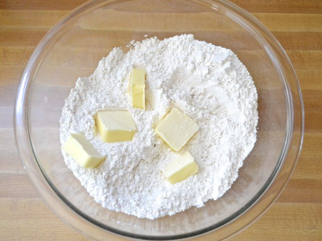 Butter added to dry ingredients in mixing bowl