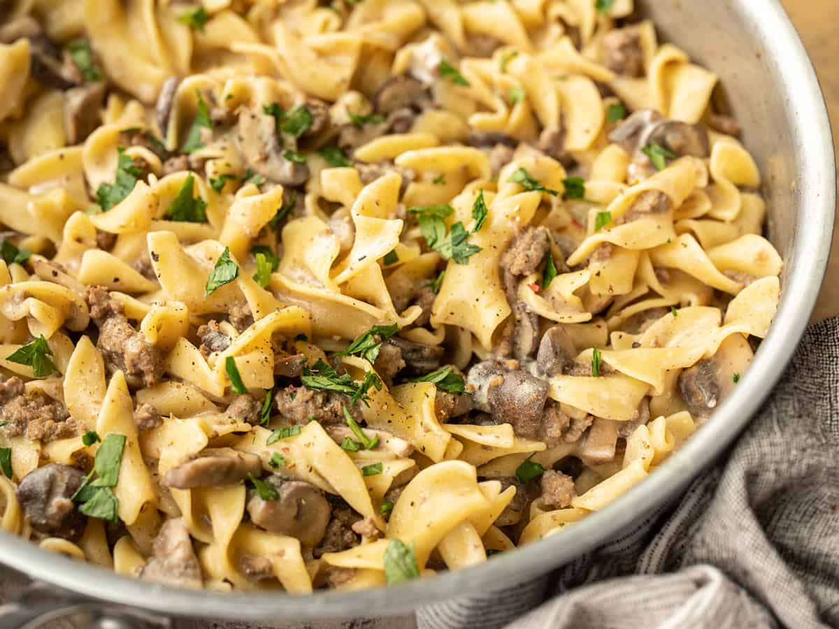 close up side view of beef and mushroom stroganoff in the skillet
