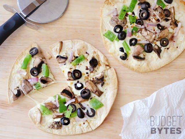 Cut Quick Fix Salad Bar Pizza with pizza cutter