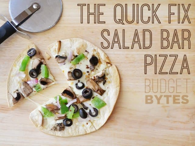 top view of Quick Fix Salad Bar Pizza with pizza cutter